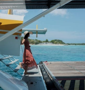 Stepping off a seaplane to explore a secluded paradise in the heart of the remote Anambas Archipelago at Bawah Reserve, Indonesia